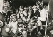 LODZ, POLAND - CIRCA 1985: A group of unidentified children (siblings, cousins and friends) pose for