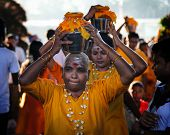 KUALA LUMPUR - JANUARY 27: Hindu devotees carry milk pots or 'pal kodum' as offerings to Lord Muruga