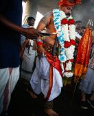 KUALA LUMPUR - JANUARY 27: A Hindu devotee performs acts of devotion to Lord Muruga while walking to