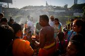 KUALA LUMPUR - JANUARY 27: A Hindu priest blesses devotees before their procession to the Batu Caves