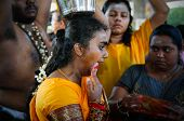 KUALA LUMPUR - JANUARY 27: A Hindu devotee goes into a trance to perform acts of devotion to Lord Muruga walks to the Batu Caves temple in Malaysia on January 27, 2013 at the Thaipusam festival.