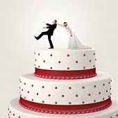 gromm try to escape from wedding cake topper