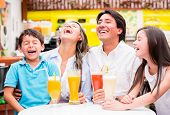 stock photo of diners  - Happy family at the diner enjoying together and laughing - JPG