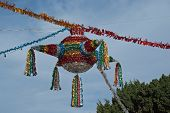 stock photo of pinata  - A colorful pinata hangs over the town square of San Jose del Cabo Mexico - JPG