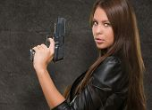 Portrait Of A Woman Holding Gun against a grunge background