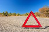 One red warning triangle on a road