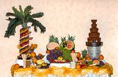 Fruit Buffet On Wedding Table And Chocolate Fountain