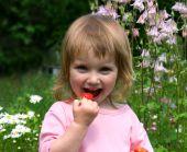 Little Girl Eat The Strawberry