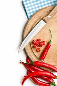 top view of chopped chili pepper on cutting board on white background