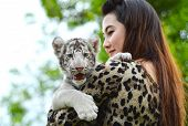 stock photo of white tiger cub  - pretty women hold baby white bengal tiger - JPG