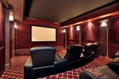 stock photo of movie theater  - Theater in luxury home with large leather chairs - JPG