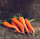 stock photo of crunch  - Fresh Organic Carrots On Wooden Background - JPG
