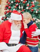 stock photo of nicholas  - Boy telling wish in Santa Claus - JPG