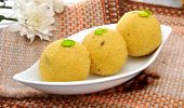 stock photo of laddu  - Delicious, fresh and traditional Indian laddoo in plate