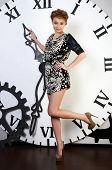 The beautiful elegant  woman on clockwork background