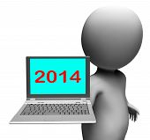 Two Thousand And Fourteen Character And Laptop Shows New Year 2014