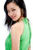 image of halter-top  - An attractive Asian woman in a green halter top on white background - JPG