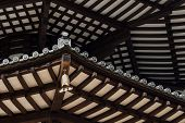 stock photo of rafters  - Underside view of Rafter Beams of Japanese Pagoda Roof with Chime - JPG