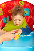 Hungry Baby Eating Puree