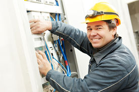 stock photo of electricity meter  - One electrician builder at work installing energy saving meter into electric line distribution fuseboard - JPG