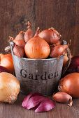 stock photo of red shallot  - Set of golden red onions and shallots in a wooden bucket - JPG
