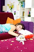 Girl Teenager Sleeping On Couch At Home Surrounded By Chips