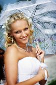 Happy Bride With Umbrella In Wedding Walk
