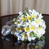 wedding bouquet of frangipani on the mirror table