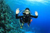 Young woman scuba diver having fun