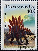 a stamp printed in Tanzania shows dinosaur Stegosaurus