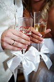 Wedding Champagne Glasses And Bride And Groom Hands