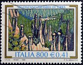 ITALY - CIRCA 1999: A stamp printed in Italy shows Earth Pyramids in Segonzano circa 1999