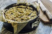 Crumble Pie With Black Currants On Baking Paper