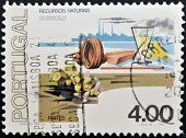 PORTUGAL - CIRCA 1977: A stamp printed in Portugal dedicated to resources beneath shows pyrite
