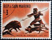 SAN MARINO - CIRCA 1961: A stamp printed in San Marino dedicated to hunting shows Wild boar hunt