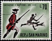 SAN MARINO - CIRCA 1961: A stamp printed in San Marino dedicated to hunting shows hunter and beater