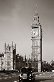 Vintage taxi on Westminster Bridge with Big Ben in London. Black and white