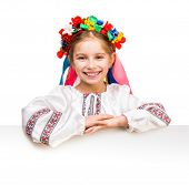 picture of national costume  - happy little girl in the Ukrainian national costume behind white board with space for text - JPG