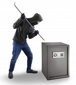 Burglar Tries To Open a Safe Deposit Box