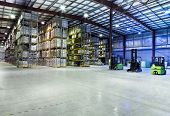 pic of picking tray  - Large modern warehouse with three standing forklifts - JPG