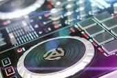DJ turntable sound mixer in nightclub