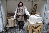 Geneva - December 15: Simulation of Middle Age process of stone treatment to create the architectura