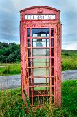 pic of phone-booth  - Detail of old red English phone booth in countryside United Kingdom - JPG