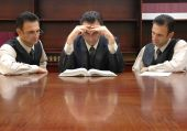 picture of lawyer  - clones of lawyer reading criminal law book - JPG