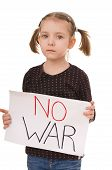 stock photo of anti-terrorism  - Sad little girl sad little girl is holding poster with sign anti - JPG