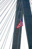 Detail of Leonard Zakim bridge in Boston with american flag