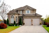 New detached single family brick luxury home