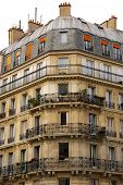 Old apartment buildings with wrought iron balconies in Paris France