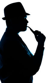 stock photo of thinkers pose  - Silhouette of a man wearing a hat and smoking pipe - JPG