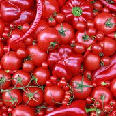 Studio composition of red vegetables pepper tomato